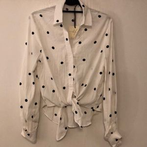 Brand new!  Polka dot blouse with tie front.